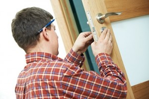 man-fixing-door-lock
